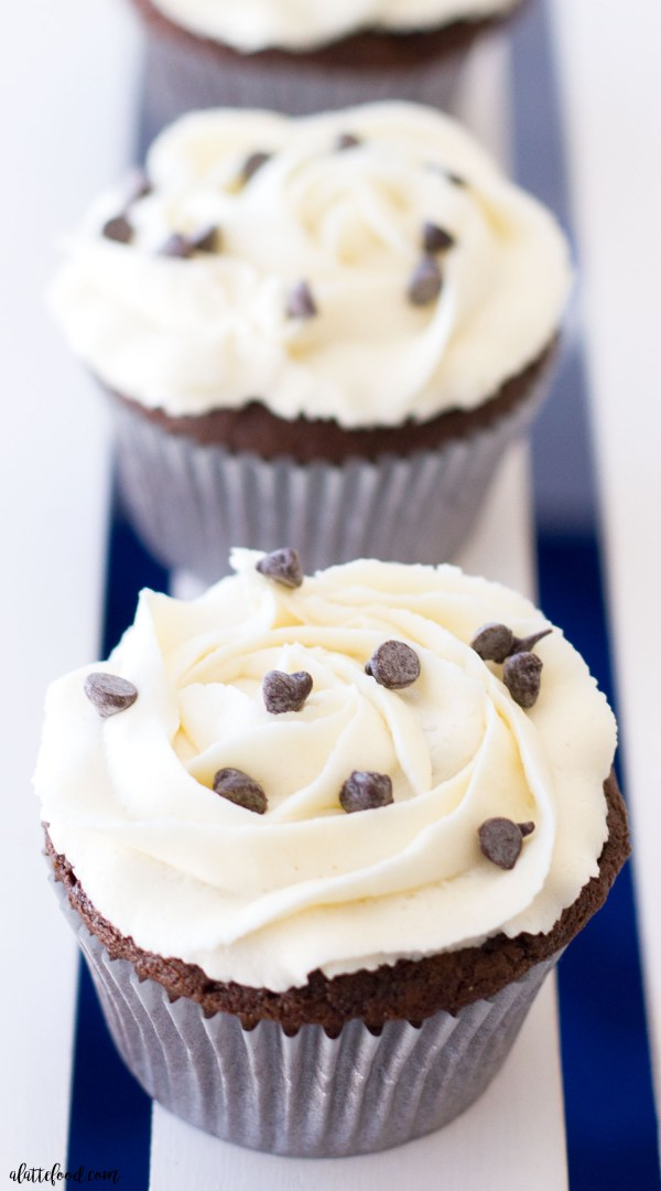 This homemade chocolate cupcake recipe is filled with an Oreo truffle filling and topped with homemade vanilla buttercream frosting! This easy chocolate cupcake recipe is rich and full of flavor, and the surprise-inside Oreo truffle is so much fun!