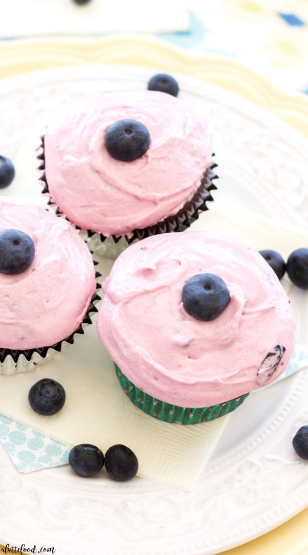These homemade milk chocolate cupcakes are topped with fresh blueberry frosting! Chocolate and sweet berries make this chocolate cupcake recipe a dessert recipe for the archives!