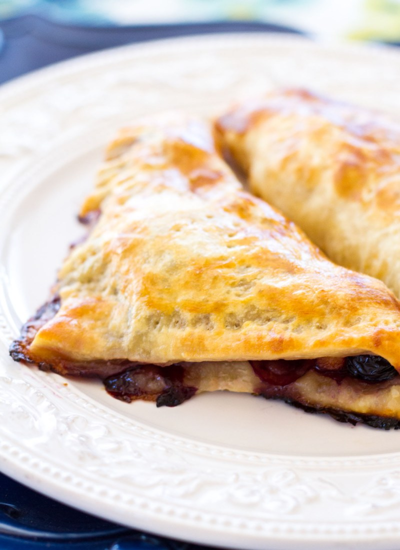 These easy peach blueberry turnovers are made with only a few ingredients and perfect for breakfast, brunch, or dessert! These homemade peach blueberry turnovers use fresh peaches, blueberries, and frozen puff pastry dough!