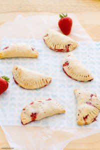 Strawberry Hand Pies | These mini pies are filled with sweet strawberry filling inside of a cream cheese crust | www.alattefood.com
