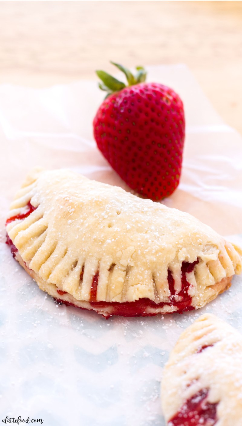 These easy strawberry hand pies have a cream cheese crust and are filled with homemade strawberry pie filling! This strawberry hand pie recipe is perfect for spring or summer dessert! strawberry, strawberry pie, pie
