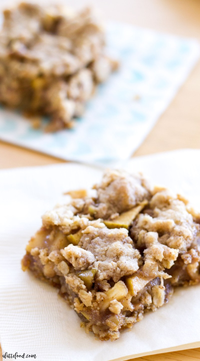 Homemade apple pie meets homemade oatmeal cookies in this Apple Pie Crumb Bar recipe! Sweet apple filling is sandwiched between an oatmeal cookie crust, making the perfect dessert bar!