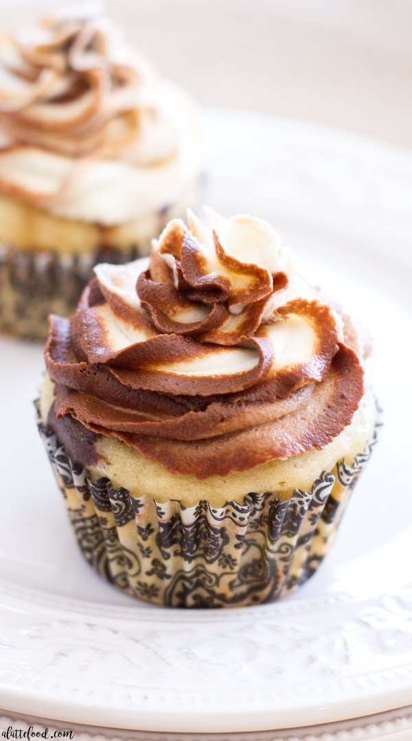 Homemade chocolate cake and homemade vanilla cake is swirled together to create a gorgeous Chocolate Vanilla Marble Cupcake recipe! Homemade chocolate buttercream and homemade vanilla buttercream are swirled together to make a beautiful marble buttercream!