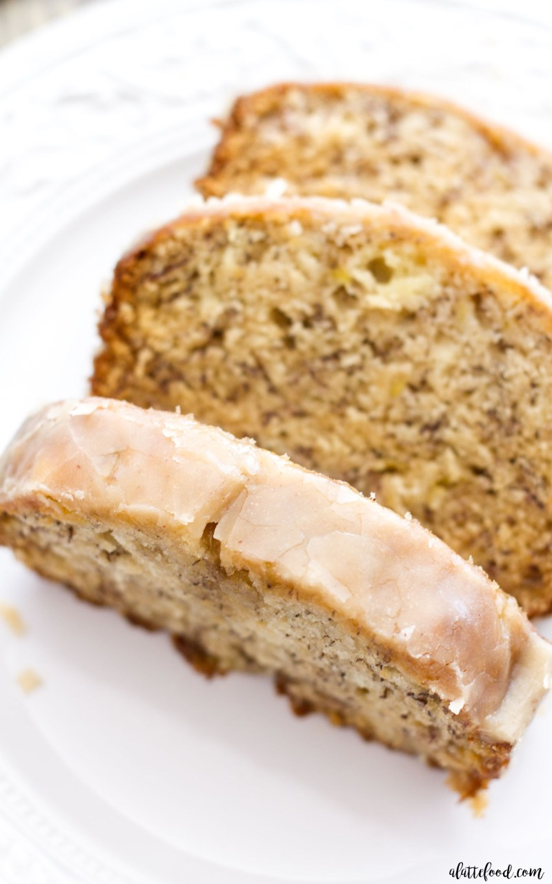 This maple glazed banana bread is an updated take on the classic banana bread recipe! This recipe begins with my mom's banana bread recipe, and ends with a sweet maple glaze that is out of this world delicious! Your life may never be the same again. banana bread, banana bread recipe, maple banana bread