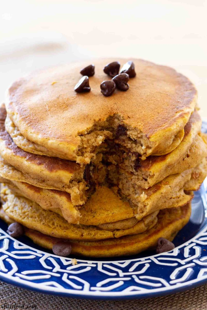 pumpkin pancakes with a bite missing from the stack
