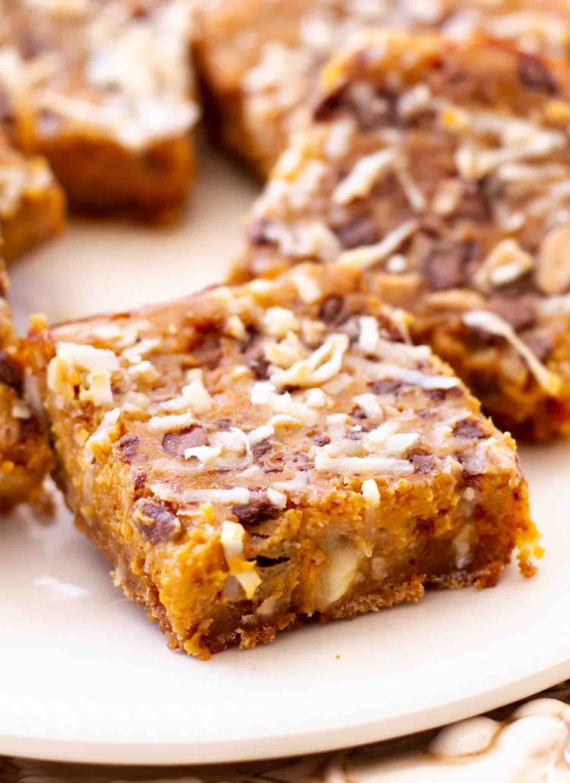 seven layer pumpkin dream bars baked and cooled on white plate