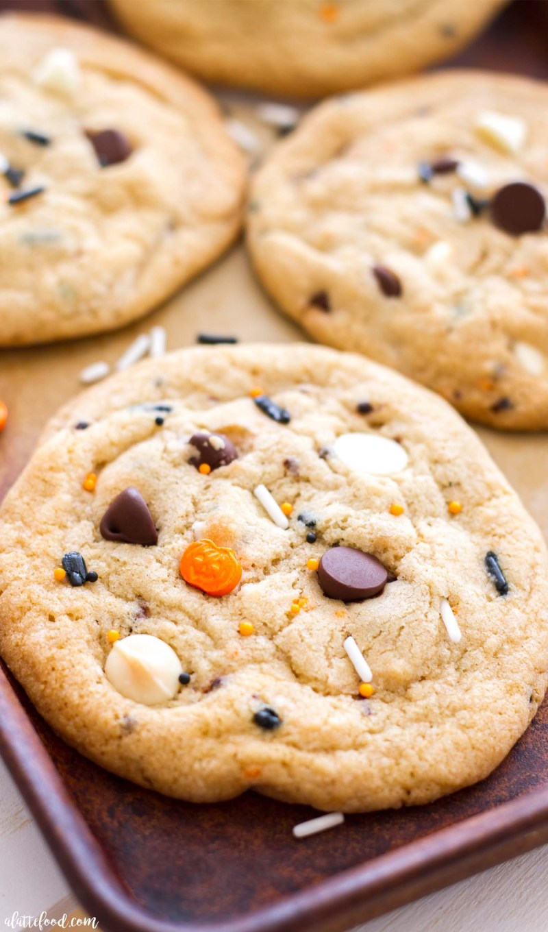 These homemade cake batter chocolate chip cookies are made 100% from scratch and all dressed up for Halloween! These classic chocolate chip cookies have a little something extra in them to give them that cake batter cookie flavor that's out of this world good!