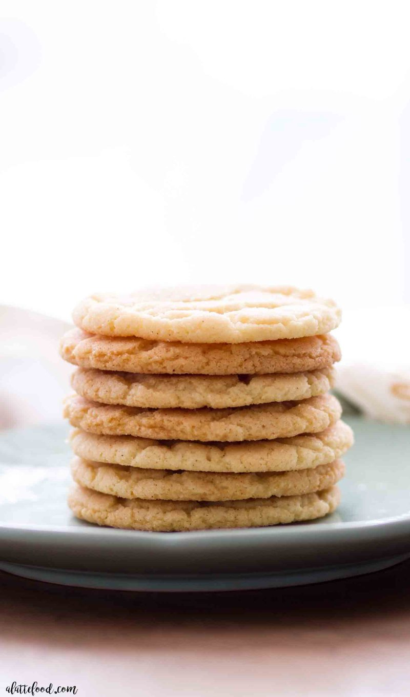 homemade snickerdoodle cookies stacked on top of each other