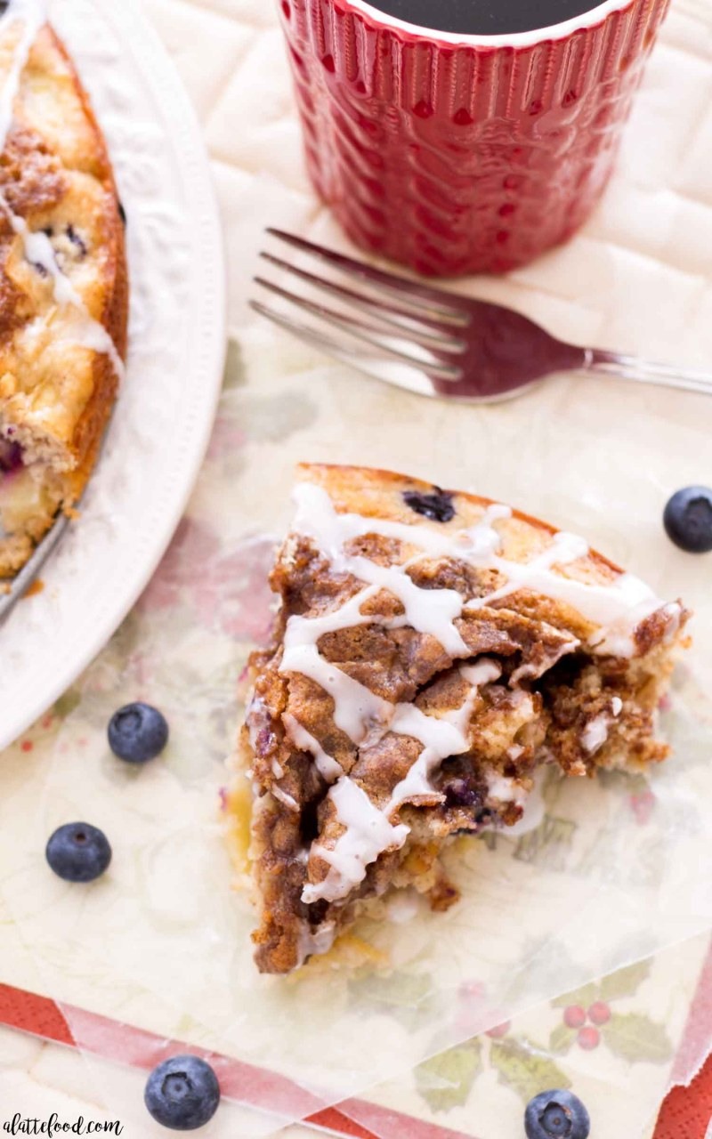 Apple Blueberry Coffee Cake slice with a vanilla glaze on top.