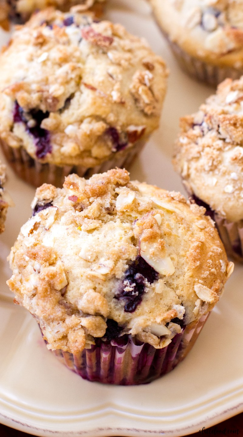 These easy homemade Blueberry Orange Crumb Muffins have a sweet streusel topping, and are the best reason to get up in the morning! These blueberry muffins are light and fluffy, and have the sweetest orange flavor! These Blueberry Orange Crumb Muffins would be the perfect Mother's Day breakfast or brunch addition!