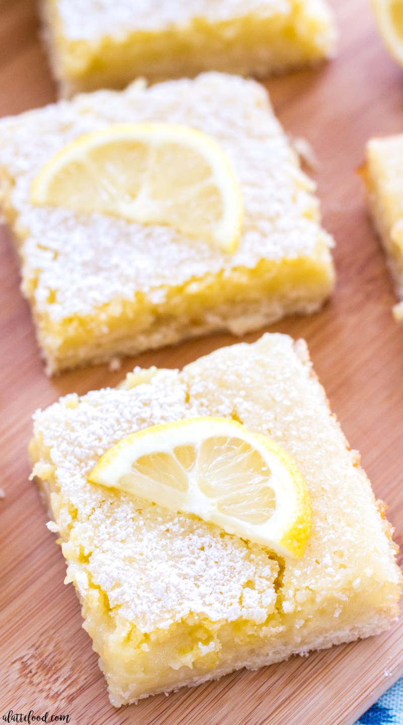 These classic homemade lemon bars have a tangy lemon filling and a sweet shortbread crust! These are the perfect Easter dessert, spring dessert, or summer dessert! lemon, lemon bars, dessert bars