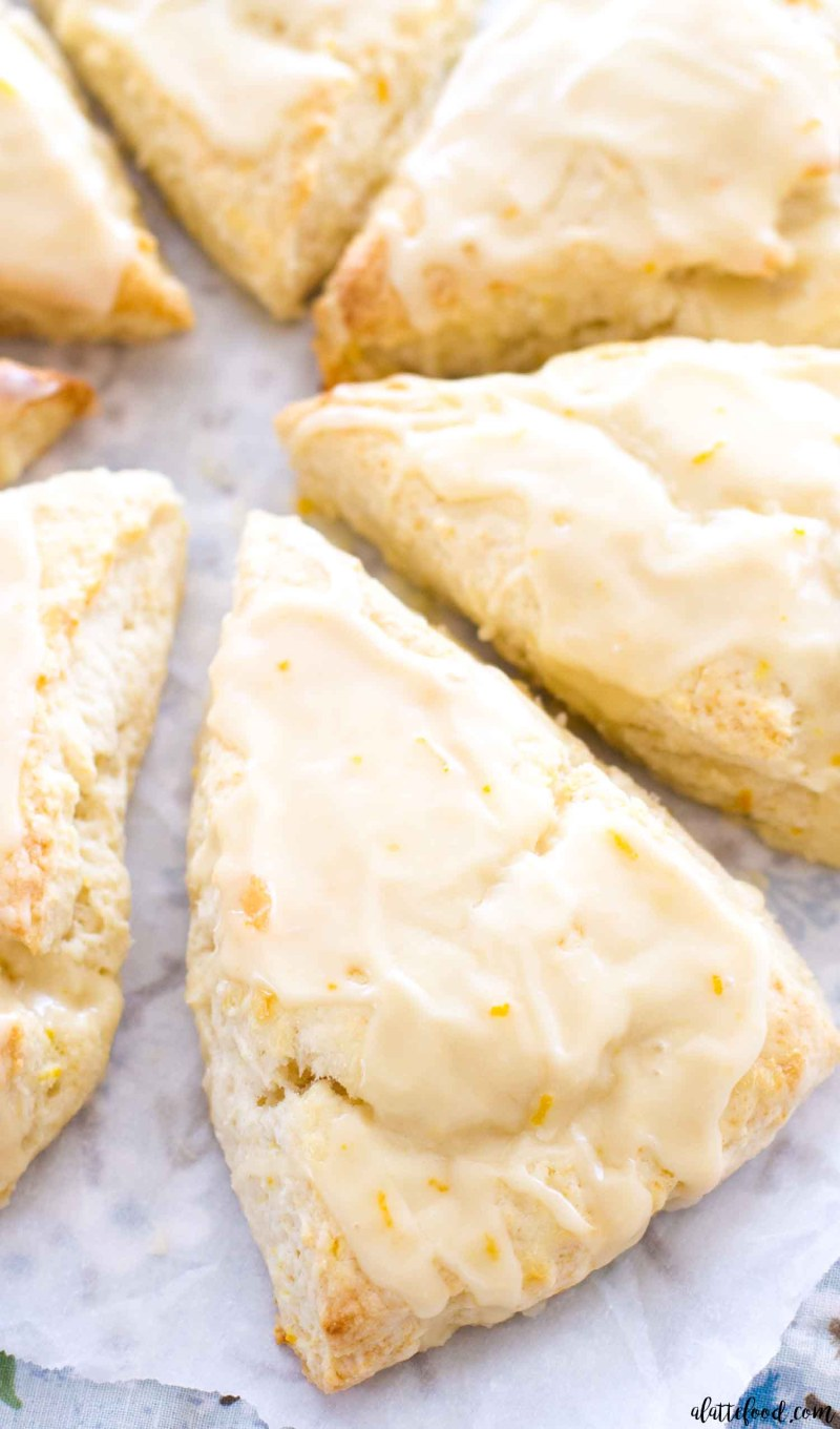 These homemade Orange Cream Scones are one of my favorite summer dessert recipes! These tender cream scones are packed with orange flavor and topped with a sweet homemade orange glaze, making them a perfect breakfast, brunch, or dessert!