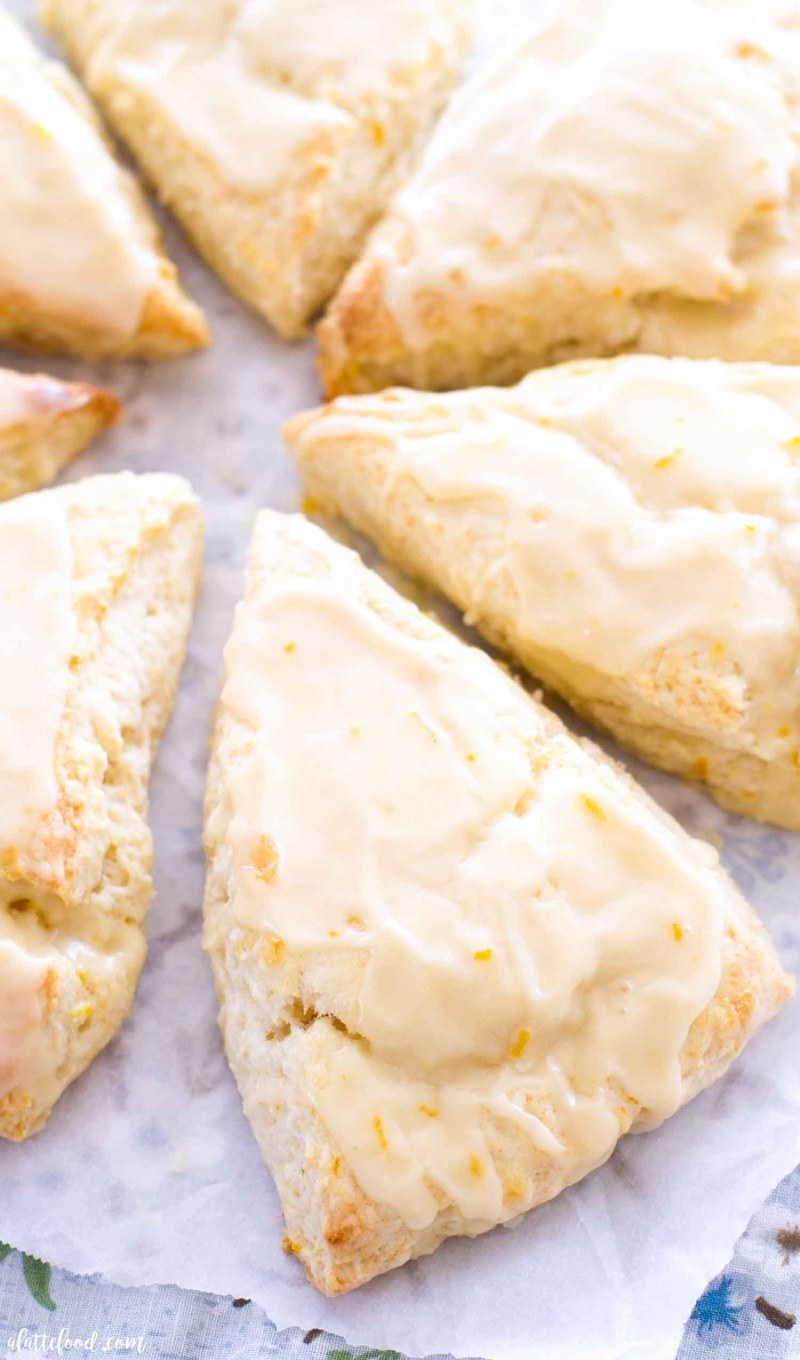 orange glazed scones on wax paper