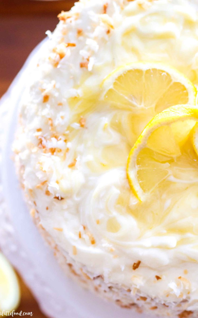 whole lemon coconut cake on cake stand