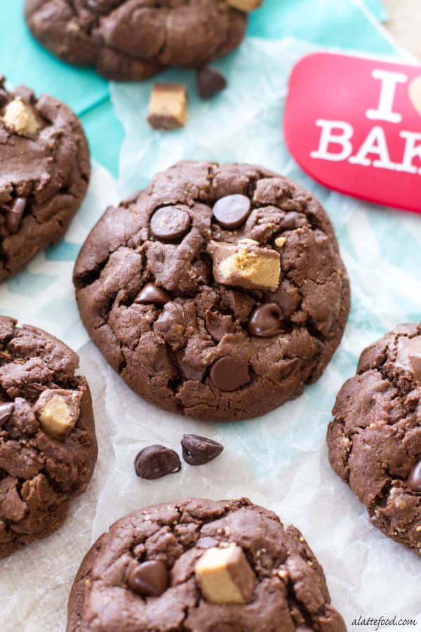 These thick and chewy double chocolate chip cookies are made with half butter, half peanut butter, and lots of cocoa powder! Plus, they're jam packed with Reese's bites, which takes the classic combination of peanut butter and chocolate to a whole new level! You won't regret these. | www.alattefood.com