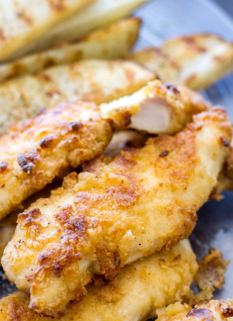 These Oven Baked Ranch Chicken Tenders are baked in the oven instead of fried. These chicken tenders are marinated with ranch dressing, giving this homemade chicken tender recipe incredible flavor! They're a total crowd pleaser.