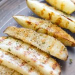 {Grilled} Black Pepper Parmesan Potato Wedges