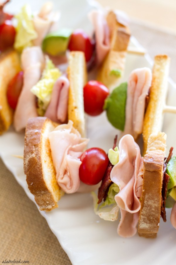 These deconstructed turkey club sandwiches are packed with the works: turkey, bacon, avocado, cheese, tomatoes, and toasted bread!  | www.alattefood.com