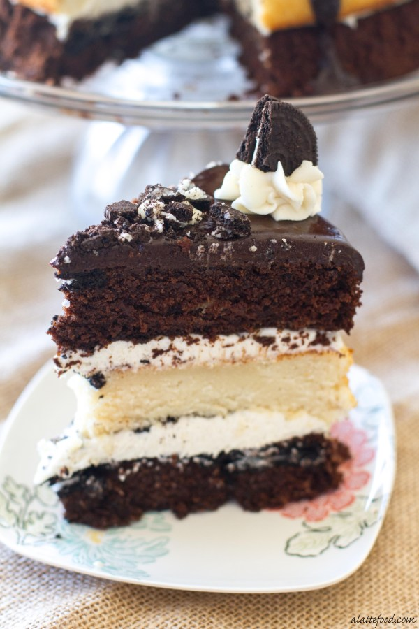 Layers of chocolate and vanilla cake are filled with vanilla frosting, crushed Oreos, and topped with a chocolate ganache. | www.alattefood.com