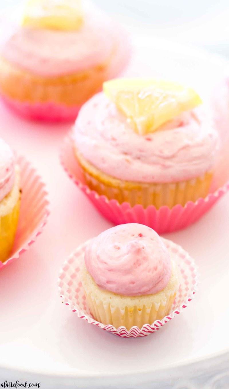 mini lemon raspberry cupcake on white cake stand