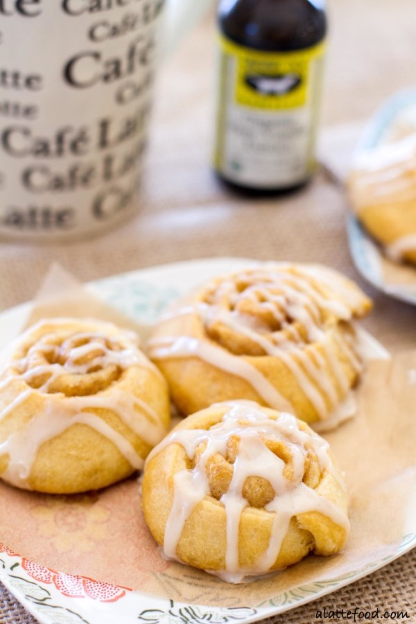 These bite-sized cinnamon rolls are full of gooey cinnamon vanilla filling and topped with a vanilla coffee glaze!   www.alattefood.com