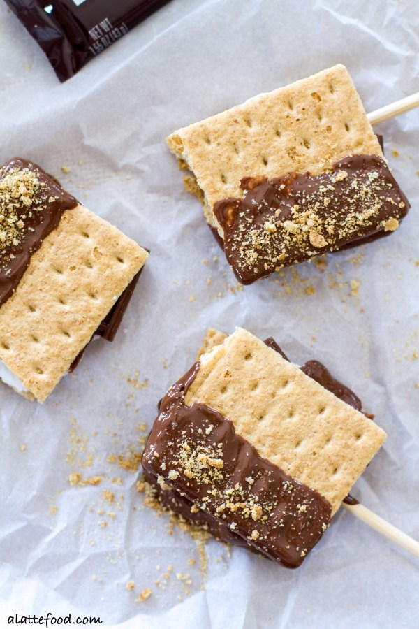 These fun, tasty s'mores pops have all the campfire taste without the campfire! Made indoors, you can have these s'mores any day of the week!  www.alattefood.com