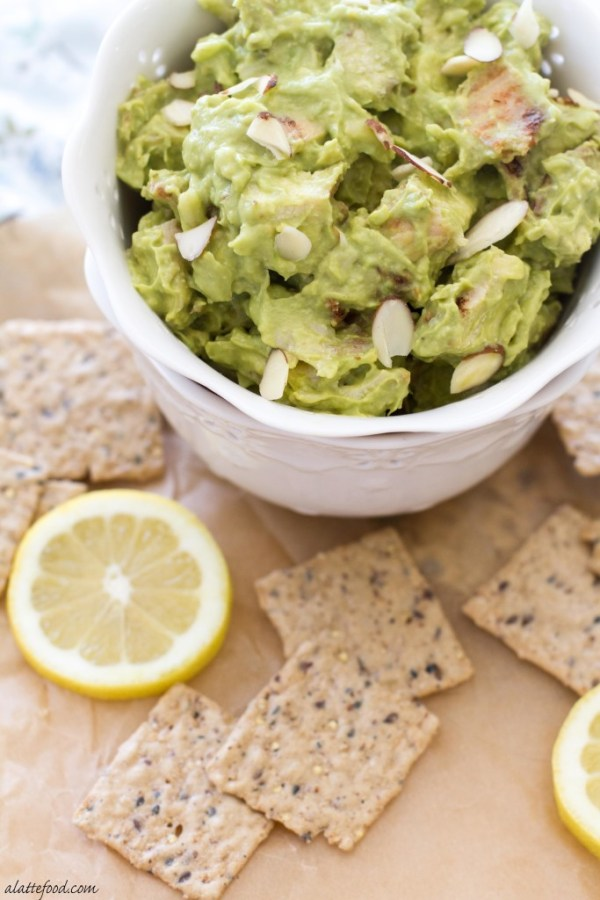 This simple chicken salad is made with avocado, sour cream, lemon juice, almonds, and pepper jack cheese. | www.alattefood.com