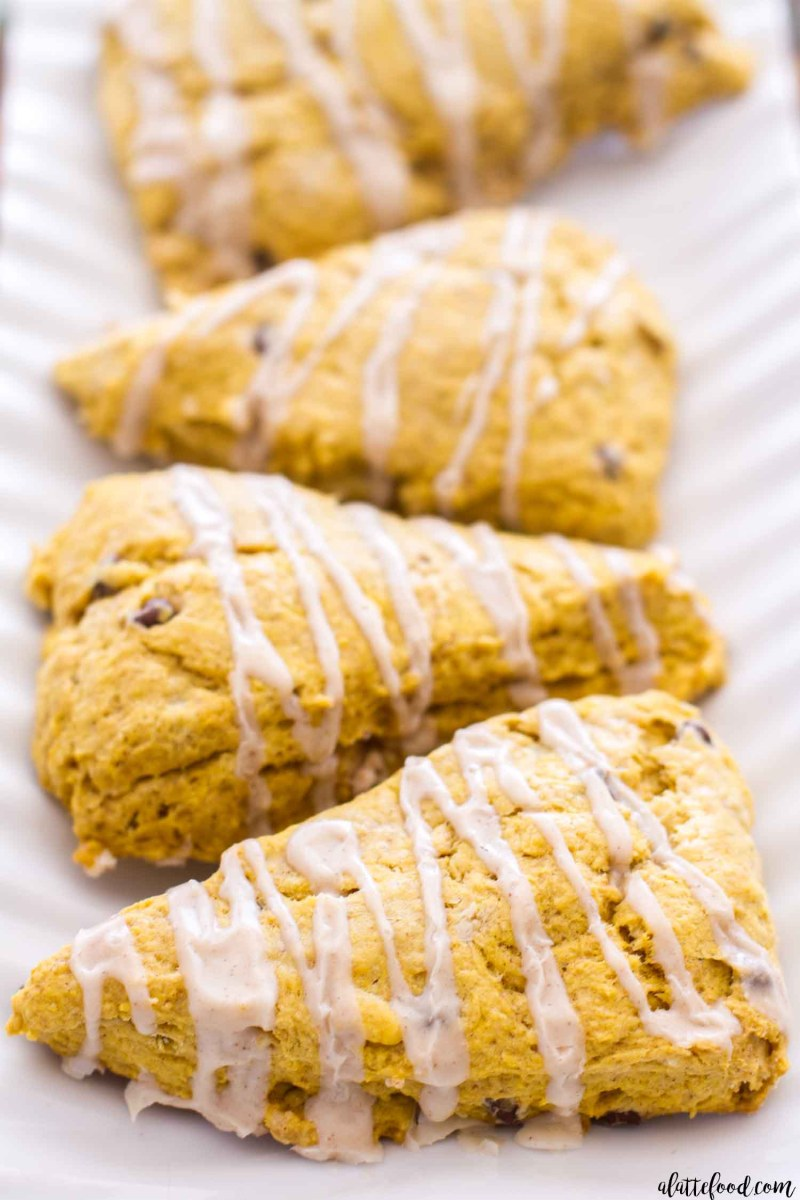 These Pumpkin Chocolate Chip Scones are packed with pumpkin puree, pumpkin pie spices, and sweet chocolate chips! Plus, these homemade pumpkin scones are topped with a cinnamon vanilla glaze! One of my favorite easy fall recipes of all time! homemade pumpkin scones, how to make scones, moist pumpkin scones