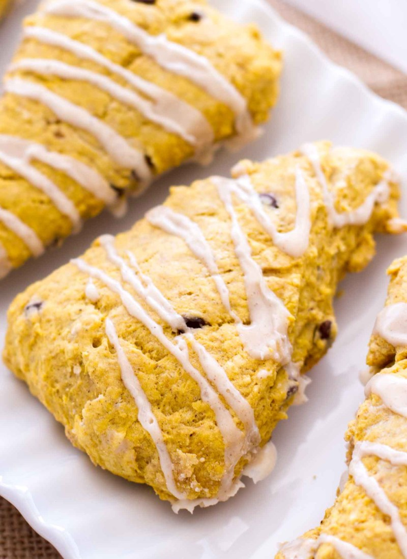 These Pumpkin Chocolate Chip Scones are packed with pumpkin puree, pumpkin pie spices, and sweet chocolate chips! Plus, these homemade pumpkin scones are topped with a cinnamon vanilla glaze! One of my favorite easy fall recipes of all time! #pumpkin #breakfast #recipe #dessert #fall #scones #pumpkinscone