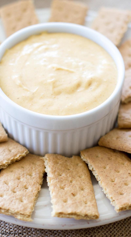 creamy pumpkin pie fluff dip in white dish