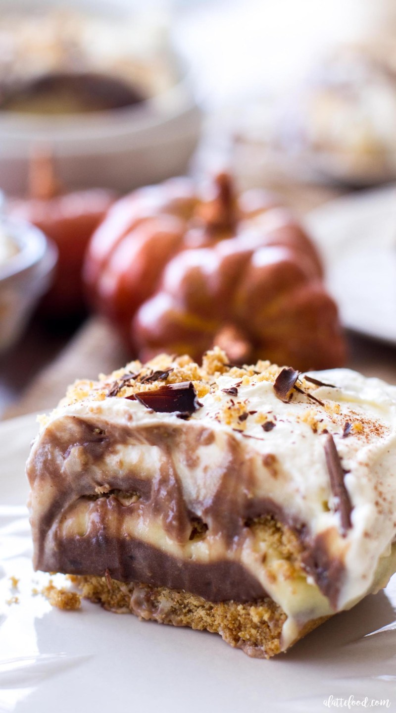 This no-bake fall dessert is layers of homemade whipped cream, homemade graham cracker crust, pumpkin spice pudding, and rich chocolate pudding. This Chocolate Pumpkin Spice Lush is a simple fall recipe perfect for any holiday party!