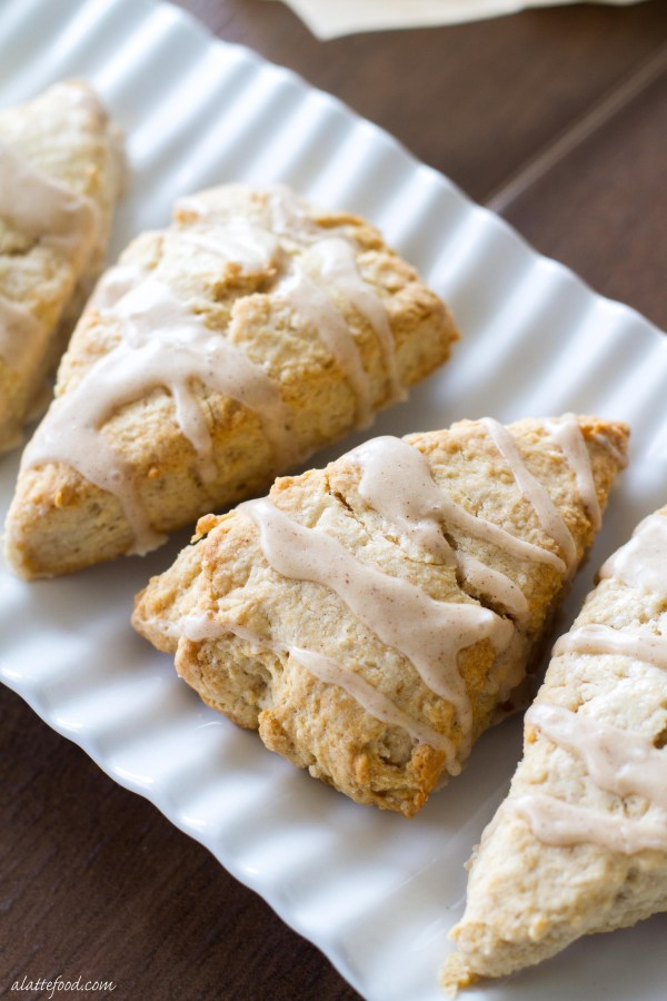 These light and flaky scones are full of sweet maple flavor and topped with a cinnamon spice glaze!