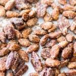 cinnamon sugar candied nuts on metal pan