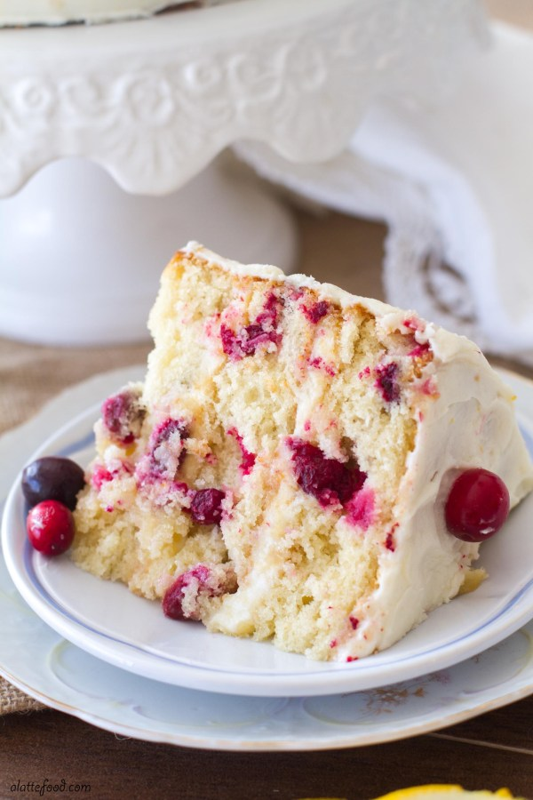 This easy cranberry orange cake is the perfect Christmas dessert! Loaded with cranberries and sweet orange flavor, this cake recipe is quickly becoming a family favorite!