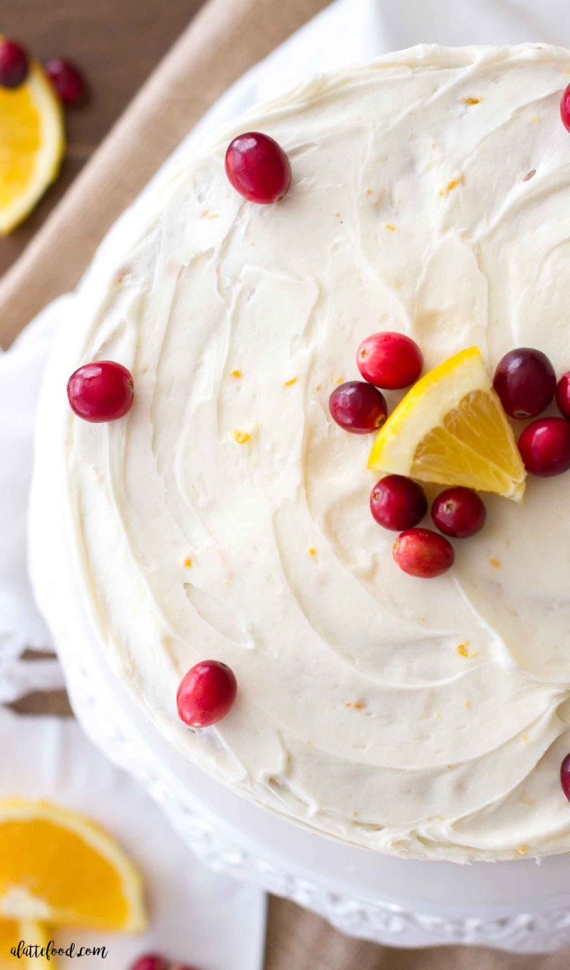 This easy cranberry orange cake is the perfect Christmas dessert! Loaded with cranberries and sweet orange flavor, this homemade cranberry orange cake recipe is a family favorite! Plus, this is topped with an orange cream cheese frosting that is rich, creamy, andultra-delish!