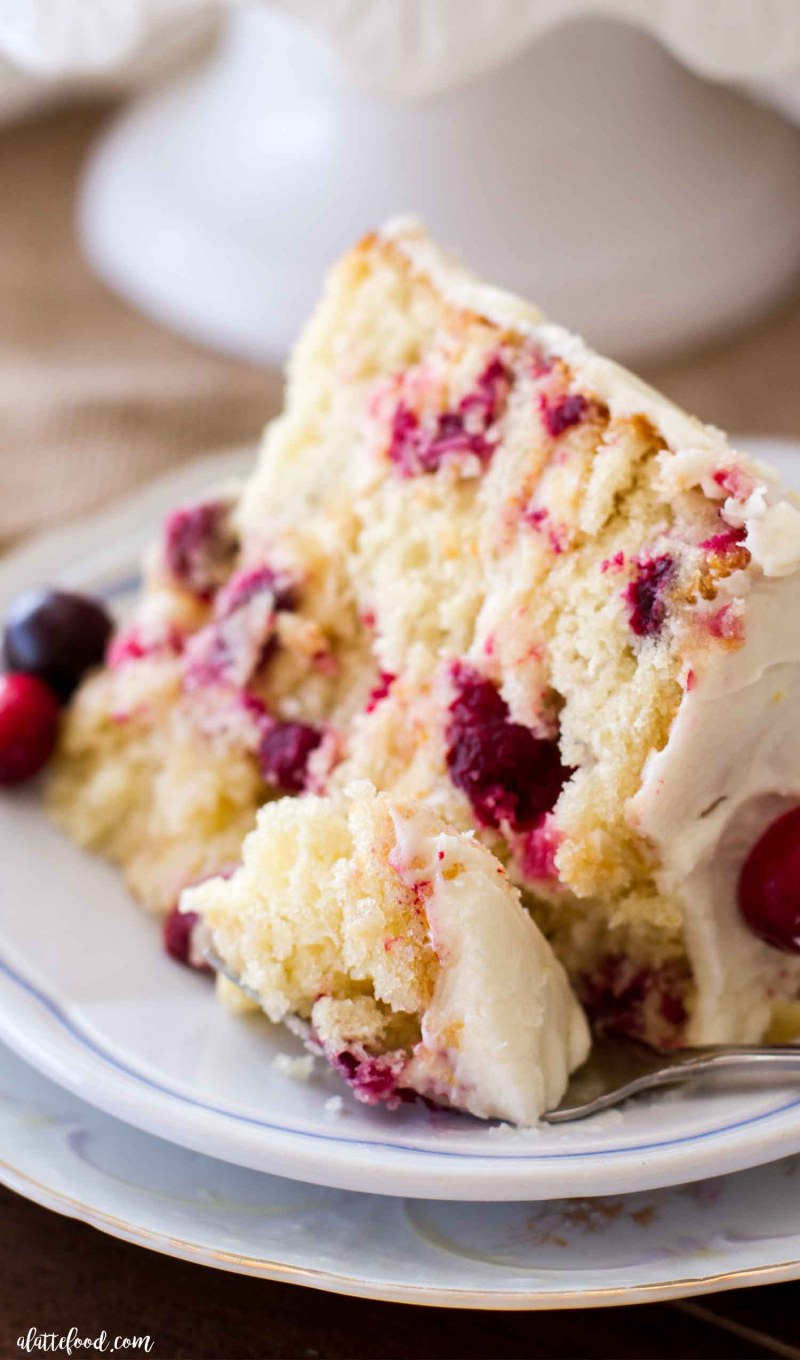 cut cranberry orange cake slice with bite on a fork
