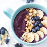 This healthy smoothie bowl is made with mixed berries, Greek Yogurt, and almond milk. With blueberries, bananas, almonds, and granola as toppings, this easy smoothie bowl recipe is the ultimate breakfast of champions.