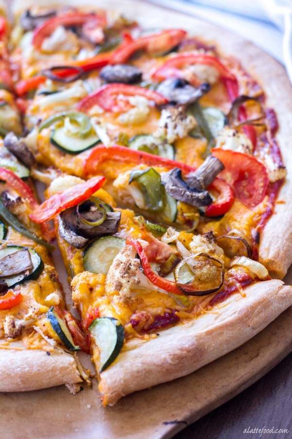 This easy pizza recipe is made with roasted vegetables and Sargento® Sharp Cheddar cheese to make a vegetarian comfort food!