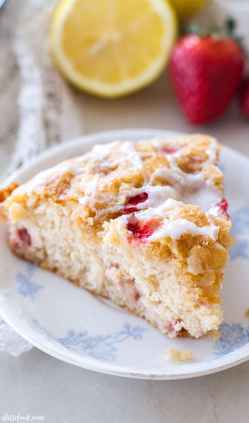 This strawberry lemon coffee cake recipe is light, fluffy, and packed with sweet strawberry and tangy lemon flavor! This easy coffee cake recipe makes for the best breakfast or brunch recipe! And, thanks to the flavors, it's the picture of spring. homemade coffee cake, the best coffee cake recipe, strawberry coffee cake, lemon cake