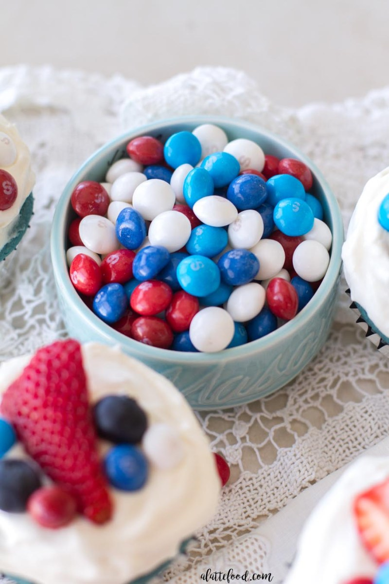 These festive red, white, and blue velvet cupcakes are made with one batter and topped with a simple cream cheese frosting! The perfect summer dessert for any occasion!