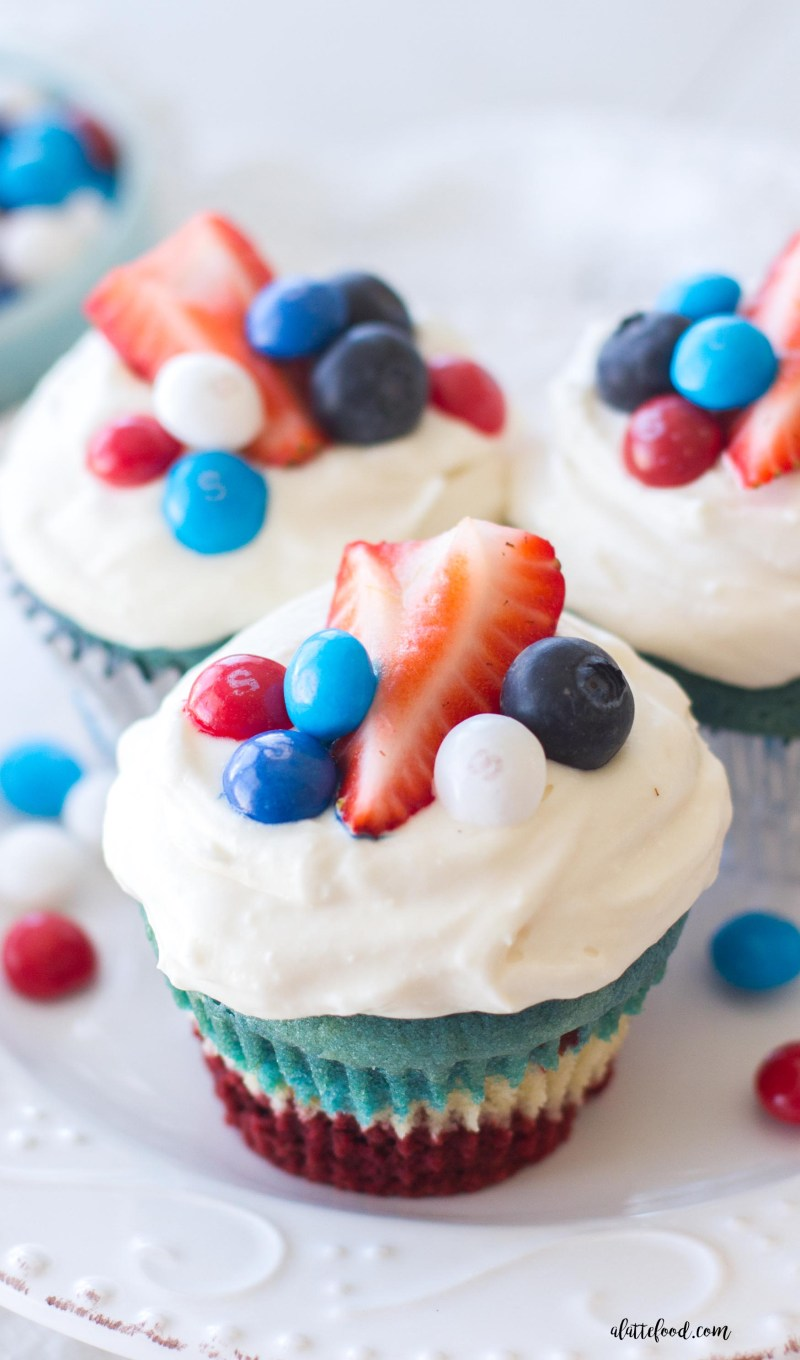 These festive red, white, and blue velvet cupcakes are made with one batter and topped with a simple cream cheese frosting! The perfect summer dessert for any occasion! 4th of July, 4th of July desserts, red velvet