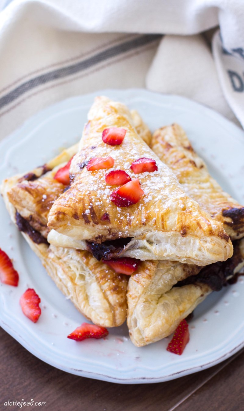 This easy chocolate turnover recipe is filled with strawberries and Nutella to make the perfect breakfast, brunch, or dessert! Simple, delish, and chocolatey. What more could you want?