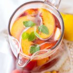This easy homemade iced tea recipe is filled with fresh peaches, sweet raspberries, and brewed Bigelow tea for a drink you'll want all summer long!
