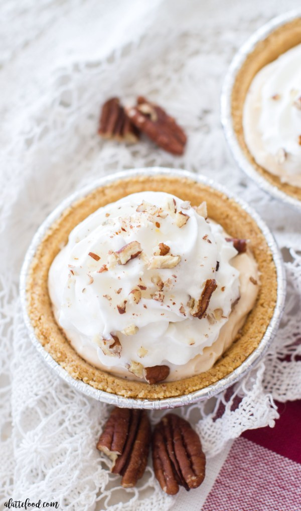 This lighter pumpkin pecan cream pie recipe is the best pumpkin dessert! It's filled with pumpkin pie Greek yogurt, cream cheese, and toasted pecans, and is topped with whipped cream!