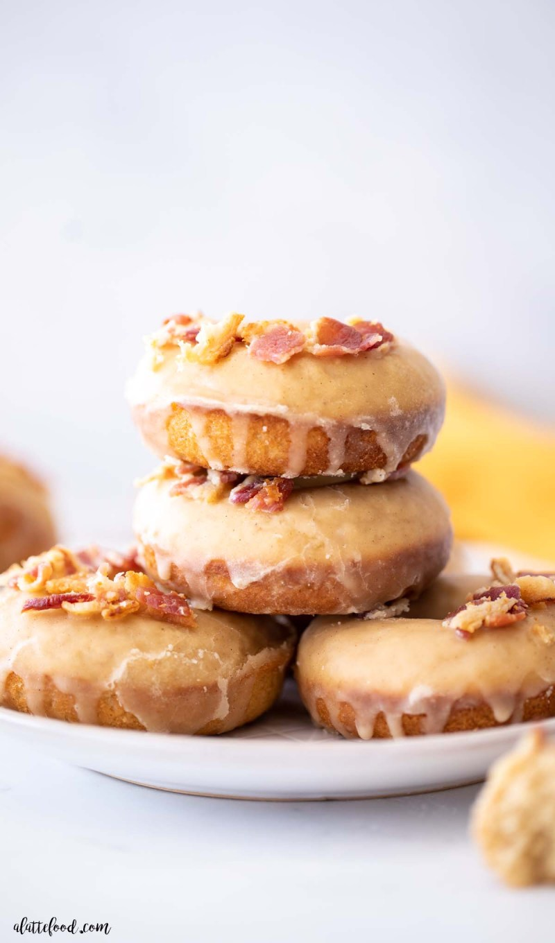 maple bacon donuts stacked on top of each other
