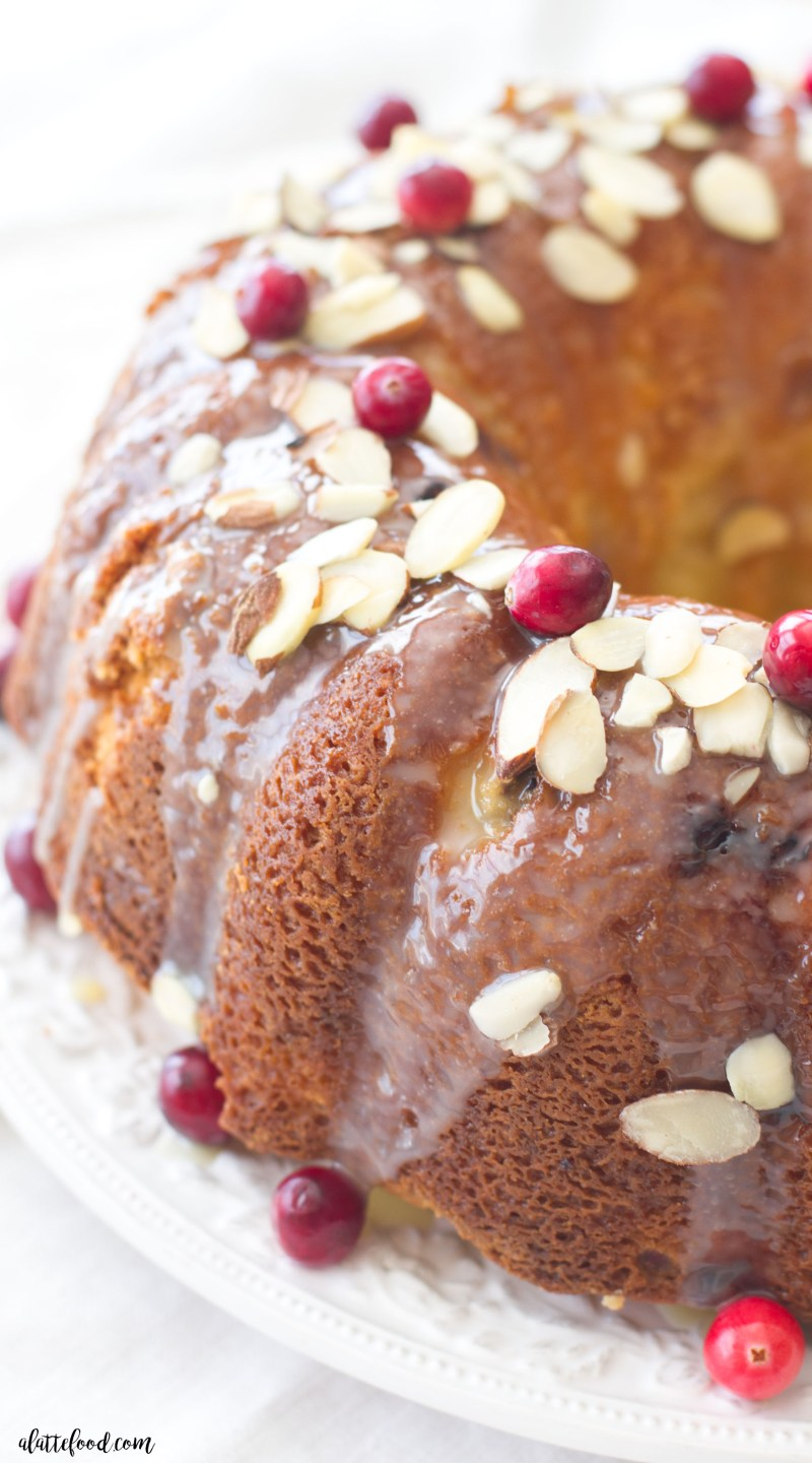 This easy cranberry almond bundt cake is made with fresh cranberries and topped with a white chocolate ganache! The sweet almond flavor pairs perfectly with the tart cranberry flavor. A fantastic Christmas dessert or Thanksgiving recipe!