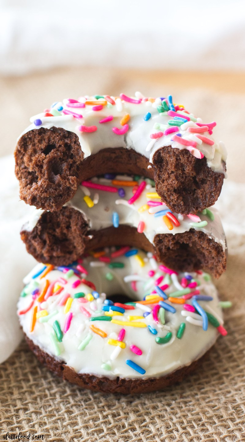 These classic baked chocolate donuts are topped with a homemade vanilla glaze and lots of pretty sprinkles! These Chocolate Sprinkle Donuts are my favorite baked donut recipe (because, chocolate) and they make a perfect easy weekend breakfast! easy chocolate donut recipe, how to make baked chocolate donuts, chocolate sprinkle donuts