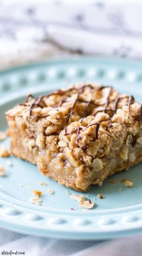 These Gooey Peanut Butter Crumb Bars have a honey graham cracker crust, are filled with the richest, gooiest peanut butter filling, and are topped with a brown sugar oat crumb topping. And a chocolate drizzle, because, I mean, who's going to complain about chocolate and peanut butter??
