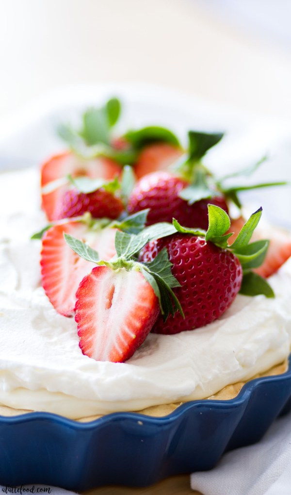 This pretty Strawberries and Cream Citrus Pie starts with a citrus shortbread crust and is layered with fresh strawberries, sweet citrus cream filling, and whipped cream. This easy dessert is light, sweet, and full of sweet strawberry citrus flavor!