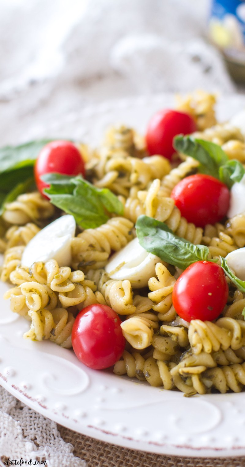 This Caprese Pasta Salad recipe is the perfect summer dish! It's made with only 6-ingredients, can be eaten both warm and/or cold, and comes together in less than 10 minutes. Caprese Pasta Salad is sure to be a new family favorite!
